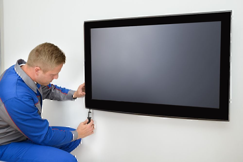 how to anchor tv to the wall